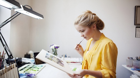 Young Woman Working In Her Painting Studio